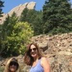 People hiking Flat Irons behind Boulder