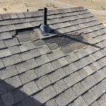 Arvada home with missing shingles and roof damage