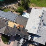 New roofing and solar panel removal and install from New Roof Plus